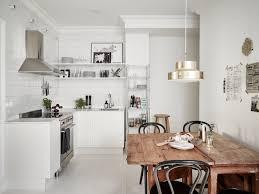 Rustic Wooden Kitchen Table Scandinavian Kitchen Table With Rustic Wooden Materials And Brass