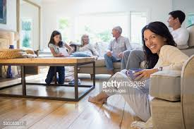 Senior Couple Hugging In Living Room Stock Photo Getty Images - Family in living room
