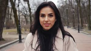 attractive middle aged women dark hair young attractive woman with long dark hair in black coat and