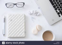 top view of a working desk with lady office supplies stock photo
