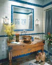 simple bathroom with blue framed wall mirror and vintage old