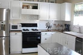 painting cabinets white before and after painting kitchen cabinets before after