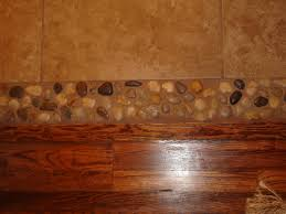 River Rock Bathroom Ideas River Rock Between The Hard Wood And Tile Good Idea Instead Of