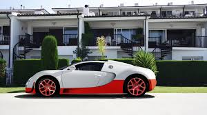 white bugatti veyron supersport bugatti super sport veyron in white and red color side view