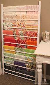 tame your stash with creative fabric storage ideas using crib side rail for fabric storage