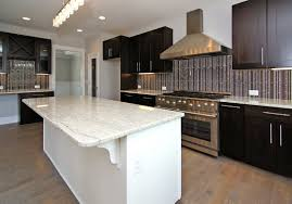 kitchen island with pull out table stunning modern kitchen with stylish vent hood also blue back