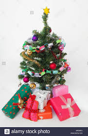 miniature christmas trees miniature christmas tree and presents stock photo 16455305 alamy