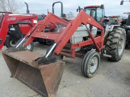 white 2 60 field boss equipped with 1510 loader white farm