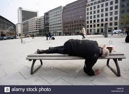 bench berlin homeless person is sleeping on a bench in berlin stock photo
