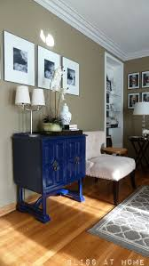 deep blue cabinet is a striking accessory to this traditional