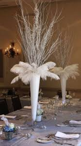 Feather And Flower Centerpieces by Wedding Designed By Event Pro Training The Blog Tells Tips And
