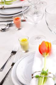 fine food and wine spring table settings with fresh tulips stock