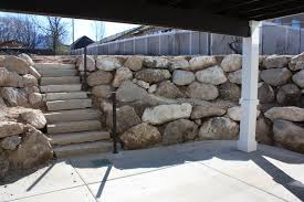walk out basement retaining wall and stone steps craftsman