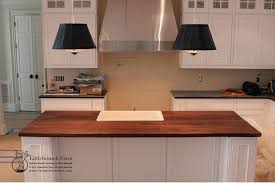 kitchen with white cabinets and wood countertops wood countertops live edge wood slabs