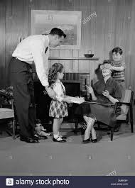 1950s family living room woman mother getting surprise gift from