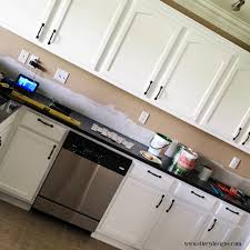 White Paint Kitchen Cabinets by Our Diy Kitchen Remodel Painting Your Cabinets White U2013 Ellery