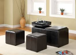 maximizing small living room spaces using black leather ottoman