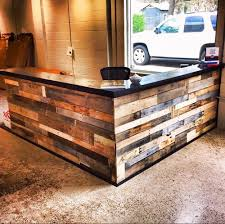 Wood Reception Desk by Reception Desk Built From Repurposed Scrap And Pallet Wood