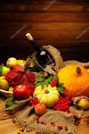thanksgiving day autumnal still with bottle of wine stock