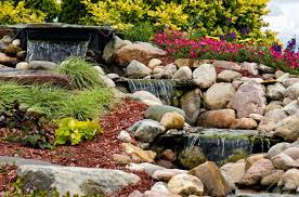Pictures Of Rock Gardens Landscaping by A Waterfall Flowing In A Rock Garden Stock Photo Picture And