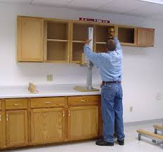 installing cabinets in kitchen cabinet lift tools equipment contractor talk