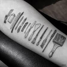 elegant tattoos of tools celebrate professions requiring skilled hands