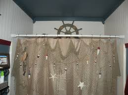 net decor i hung a decorative fishing net with wooden fish and real starfish