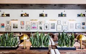 earls kitchen bar now open at legacy west plano magazine a gallery wall at the earls plano location displays art commissioned by local texas artists