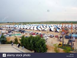 view of makeshift tent houses at flood affectees relief camp at