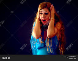 halloween long background frightened woman screaming with fear indoor at halloween night