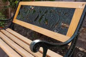 a kids small garden bench made of wood and iron stock photo
