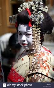 Japan   March       Close up of a beautiful Japanese Geisha posing with  parasol Pinterest