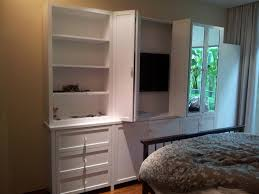 hidden tv cabinet with doors inspiration wall mounted crowdbuild