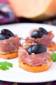 canapé pumpkin canape appetizer of pumpkin jamon ham black olives cheese