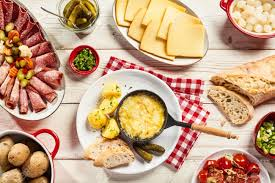 raclette cheese whole foods delicious swiss raclette cheese buffet with a platter of cold