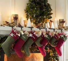 popular christmas tree with sprinkle lighting and modern fireplace