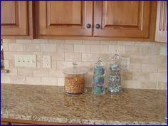 limestone kitchen backsplash subway tiles with mosaic accents backsplash with tumbled
