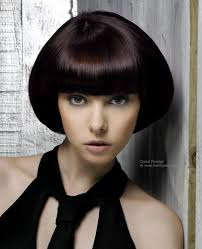 cutting hair so it curves under chin length bob cut styled flared out or glassy smooth and curving