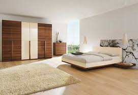 white bedroom wall with white bed floating on brown wooden board