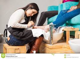 applying nail polish on a woman u0027s toes stock photo image 65445867