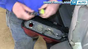 2001 jeep grand cherokee brake light how to install replace change taillight and bulb 2002 07 jeep