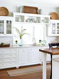 what do you put on top of kitchen cabinets what do you put on top of kitchen cabinets ideas for decorating