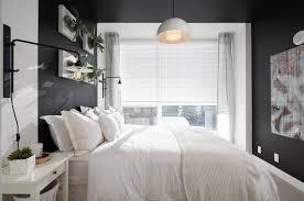 gray master bedroom ideas wooden flooring black iron bed