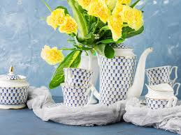 easter tea party easter tea party festive set and yellow flowers stock photo