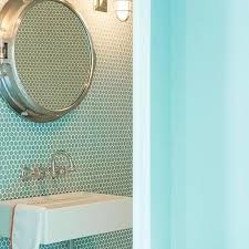 porthole mirrored medicine cabinet blue kids bathroom with turquoise penny tiles and royal naval