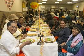 soup kitchens in island top at a manhattan soup kitchen food on the table and chops on the