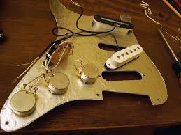 joe giampaoli shielding a strat guitar to eliminate hum and emi noise