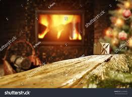 wooden desk xmas tree fireplace christmas stock photo 523182682