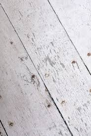 the look of distressed white washed wood floors easy to do