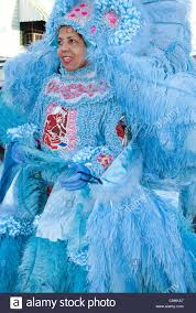 mardi gras indian costumes a woman dressed in a bright blue mardi gras indian costume stock